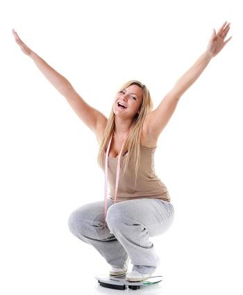 Woman Celebrating Weight Loss